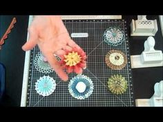 Border punches to make paper rosettes.