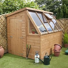 12 Wood Greenhouse Plans You Can Build On A Budget. shed design shed diy shed ideas shed organization shed plans Wood Greenhouse Plans, Backyard Greenhouse, Backyard Sheds, Greenhouse Ideas, Garden Sheds, Shed With Greenhouse, Greenhouse Plants, Greenhouse Wedding, Outdoor Sheds
