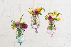 Create macrame hanging vases with string or twine.
