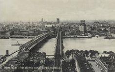 Panorama vanaf de toren van de Hef, 1930. Je ziet onder andere de Maasbruggen, het Witte Huis, de Boompjes, een deel van de Van der Takstraat en de Laurenskerk. Om de Maasbruggen is tijdens de Tweede Wereldoorlog strijd gevoerd. Kijk eens op www.strijdomdemaasbruggen.nl