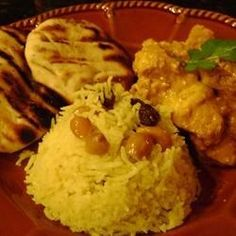 Basmati rice is simmered with coconut milk, spices, raisins, and ...