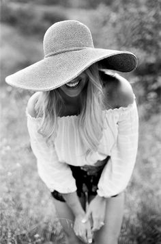 Floppy hat...Off shoulder white blouse...Denim shorts...