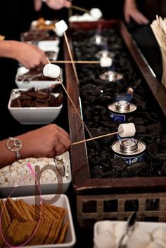 Why not add a s'mores bar to your wedding package? Both interactive and delicious!