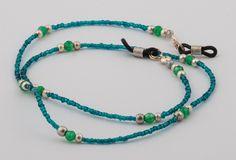 Collier porte lunettes 'la coulée verte en rive turquoise'