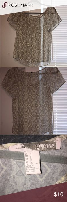 Forever21 Geo Top 100% Polyester Geometric top. This is pretty sheer so I would suggest wearing a nude bra or tank top underneath. Could fit S/M. Only worn once. In great condition! Forever 21 Tops Blouses