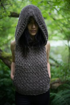 A giant over-sized hood is always on point when frolicking through forests or festivals. Hand knitted in a chunky, basketweave pattern, this
