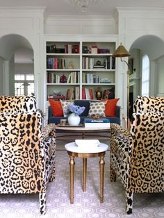 leopard chairs, arched doorways, built ins... But really it's all about the leopard chairs!