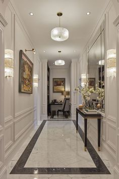 hallway flooring The main entrance hall has extravagant marble flooring and panelled walls with a library area at one end and an elegant power room skillfully hidden behind paneling off the hallway Home Room Design, Home Interior Design, Living Room Designs, House Design, Neoclassical Interior Design, Flur Design, Hall Design, Lobby Design, Entrance Hall Decor