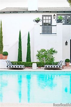 White stucco house with pool