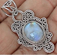 Rainbow moonstone sterling pendant  only 35.00  at Bangles and Baubles