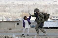 Army soldier takes five with an Afghan boy during a patrol in Pul-e Alam, a town in Logar province, eastern Afghanistan. From 45 Most Powerful Images of 2011 Powerful Images, Most Powerful, Les Religions, Support Our Troops, Army Soldier, Female Soldier, We Are The World, Military Personnel, Real Hero