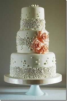 pearl wedding cake by jodi..... this could be the one.... with a coral hibiscus and a
