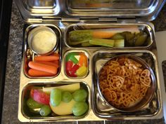 Planet Box lunches- Such a great invention! Would be great for kids lunches or adult lunches... good portion control. Plus the magnets are SO fun!