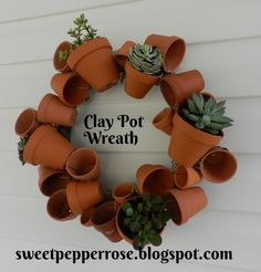 This blog shows how to make a Clay pot wreath. so cute and you could change out the colors with seasons