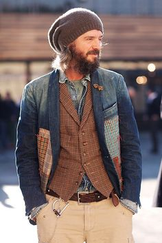 So many interesting things all rolled into one! Beard, cap, bow on lapel, tweed vest, chambray shirt, patch work!