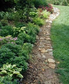 I have to get a better edge for flower beds. I have all of these rocks and want to use them but I also need to be able to have an edge to roll mower over. I might be able to use something like this. ler flat rocks