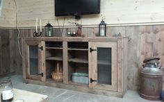 I wonder if this would work in our kitchen. See Shanty 2 Chic for plans for this entertainment center