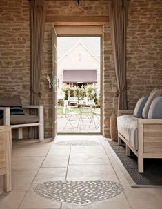 The Old Farmhouse at comes to life when The Egg Store and The Wood Store are combined. Cotswold Villages, Cotswold Cottages, Corporate Team Building, Wood Store, Rustic Home Design, Daylesford, Cozy Nook, Farmhouse Interior, Arches