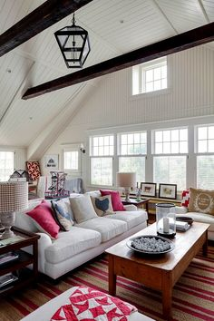 white paneling and red/white quilts