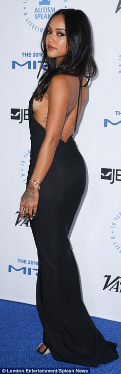 Now that's low:Keeping things extremely simple, Karrueche donned a figure hugging backless black dress with a small front split and a cascading neckline