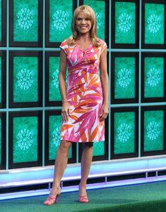 "TOMMY BAHAMA: ""Azure Palm"" dress in orange & fuchsia abstract leaf print on white background, v-neckline, cap sleeve, horizontally shirred waistband, flared skirt   Vanna White's dresses   Wheel of Fortune"