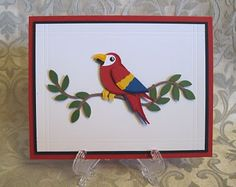 Stampin' Up!  Bird Punch - Parrot ~ http://stampndesign.blogspot.com/2010/04/artisan-award-rejects.html