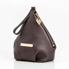 Wristlet diamond bag made of fine elk leather. This both sustainable and elegant bag is diamond shaped & inspired by the Lovia diamond cone. Elk, Diamond Shapes, Bag Making, Finland, Leather Bag, Bronze, Inspired, Elegant, Bags