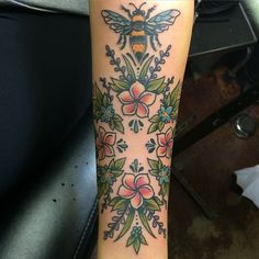 Bee and flowers tattoo by Meg McNiel
