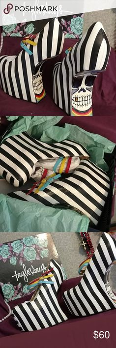 """""""IRIS"""" in B&W by Taylor Says A very daring antigravity platform wedge. B&W stripes with triple MJ straps in red, yellow and blue. Graphic sole has rainbow and skull design. Slightly imperfect exterior as pictured. New in box, but missing dust bag. How do they work? What am I, a physicist? I don't know. But they'll give you hight and they're a great conversation piece! Taylor Says Shoes Wedges"""