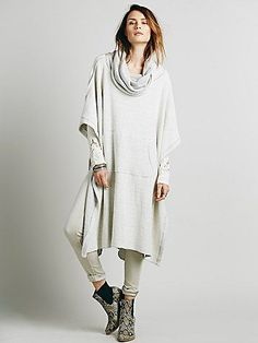 Oh You Fancy Poncho | So-soft nubby, textured poncho style layer. Oversized and effortless, with a giant cowl neck that can be worn as a hoodie. Features a kangaroo pocket. Continue to enjoy perfect outdoor days after the temperature turns a little chilly.  *FP Beach is a collection that embodies the free spirit of the seaside lifestyle with casual knit dressing, lightweight layers, and effortless shapes.