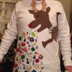 """Ugly Christmas Sweater""...glued on felt, Christmas stuff and puffy paint."