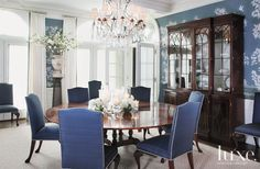 The Gracie wallpaper was hand-painted, panel by panel, right in the dining room of this home. To counteract the classicism created by the pairing of the antique sideboard with the wallcovering's chinoiserie motif, a contemporary Matthew Pillsbury photograph hangs on the wall.
