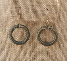 Justine Earrings: Pyrite rings wrapped with by jewelrybybellagrace