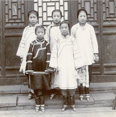 Chinese girls with bound feet, circa 1890s. Unknown photographer.