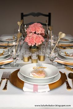 pink and gold tablescape.  cheap votives and vases just spray-painted gold on the bottom.