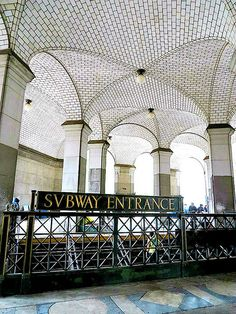 The beautiful columns and white Gustavino tiles of the vaulted ceiling in the south arcade of the Manhattan Municipal Building in New York City, completed in 1914. August 13, 2013.
