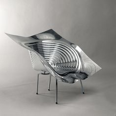 Uncut: A anodized aluminum and stainless steel chair designed by Israeli born architect, furniture and industrial designer Ron Arad. Ron Arad, Chair Design, Furniture Design, Muebles Art Deco, Cafe Chairs, Restaurant Chairs, Dining Chairs, Lounge Chairs, Chairs