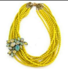 I love the idea of using a broach on your necklaces to jazz them up a bit.  Even pair multiple strands of necklaces together and hold them in place with a broach.