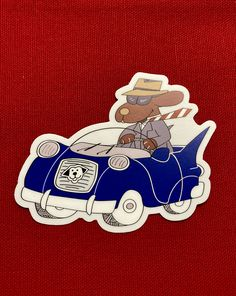 Dapper Dog sticker by Binky and Bell. Art features business dog on his way to his next appointment in his smart blue car straight out of the 50's. Great for putting on your car, laptop, favorite reusable water bottle or commuter mug. Die cut sticker is 4″ x 3.23″ Perfect little gift for any and all dog lovers! Made in USA. Free shipping within U.S.