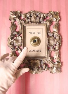 don't mind if i do. and preferably rosé! >>> I think I need to upgrade my hotels. I need to stay in one that has a button like this!