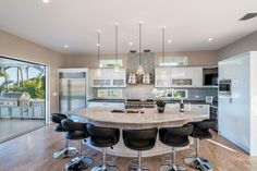 A gorgeous custom kitchen, showcasing white cabinets, top-of-the-line appliances and marbled countertops, is a modern dream.