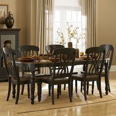 The design of Ohana Dining Room Collection captures the essence of a casual country home. Its antique black and warm cherry finish gives it a striking 2-toned apprearance. The solid wood table top with butterfly leaf and unique chair back supported by turned legs complement Ohana Collection with a touch of elegance. This group is further accented by the curio which features two sliding glass doors. It's a warm look you'll love having in your home.