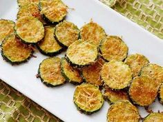 Zucchini Parmesan Crisps Recipe from Food Network. Summer's coming---I'm ready for zucchini! This looks so good and healthy, too. I'd love this with some homemade lasagna or even as an appetizer, with some savory spaghetti sauce. Zucchini Parmesan Crisps, Zucchini Chips, Parmesan Chips, Fried Zucchini, Zucchini Rounds, Healthy Zucchini, Zucchini Bites, Cooking Zucchini, Zucchini Gratin