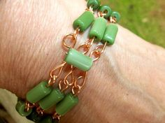 Green Cats Eye Glass Bracelet Handmade Wire by T3BodyMindandSoul Great Christmas Gift! Free Shipping in the US and for all you pinners out there, use code Pinterest to get 10% off at check out!!!