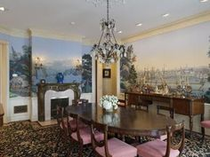 The formal dining room has a chandelier, another fireplace, and murals of waterfront life. Lurie says the room has Zuber wallpaper paneling – a technique also used at the White House –  with aquatic designs.