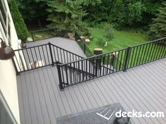 Island Oak color decking with a metal railing.