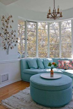 Whether you find a sofa like the curved piece above or order a custom piece to fit into your space, don't hesitate to make your window seating the hub of an arrangement that fosters conversation!