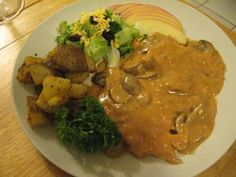 Pan Fried Chicken Schnitzel, in Jaegersauce ( mushroom sour cream gravy)