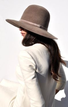 light brown hat and cream jacket