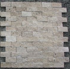 I love this split face tile. It would coordinate with my split face block fireplace perfectly : )